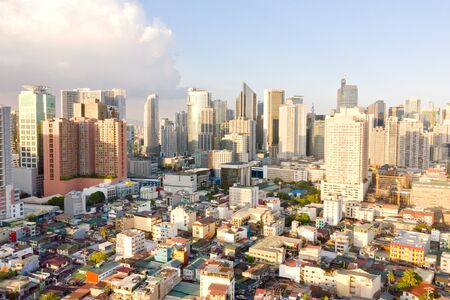 Cityscape of Makati, the business center of Manila, view from above. Asian metropolis in the morning, top view. Skyscrapers and residential neighborhoods, the capital of the Philippines. Modern city.