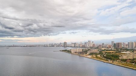 Manila city in the morning, view from above. Panorama of a large port city. City with modern buildings and skyscrapers. Manila, the capital of the Philippines. Asian metropolis.