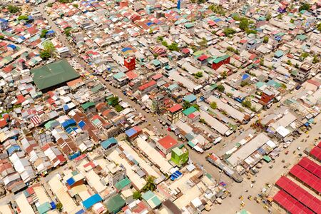 Streets of poor areas in Manila. The roofs of houses and the life of people in the big city. Poor districts of Manila, view from above. Manila, the capital of the Philippines.