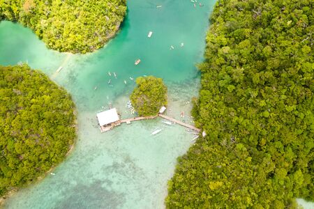 Cove and blue lagoon among small islands covered with rainforest. Sugba lagoon, Siargao, Philippines. Aerial view of Sugba lagoon, Siargao,Philippines.