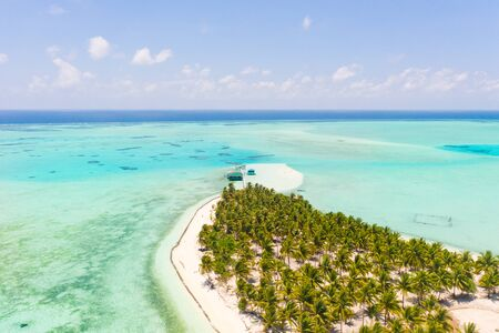 Seascape with a paradise island. Onok Island Balabac, Philippines. A small island with a white sandy beach and bungalows. Philippine Islands. Reklamní fotografie - 131333795