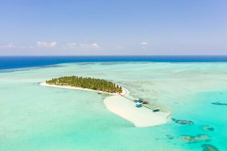 Onok Island Balabac, Philippines. The island of white sand on a large atoll, view from above. Tropical island with palm trees. Seascape with a paradise island. Reklamní fotografie - 131333473