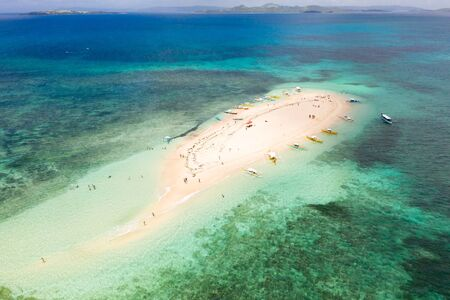 Naked Island, Siargao. The white sandy island is surrounded by a coral reef, a top view. Philippine nature.