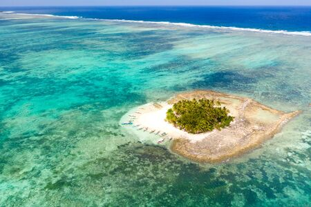 Guyam island, Siargao, Philippines. Small island with palm trees and a white sandy beach. Philippine Islands. Reklamní fotografie - 131334282