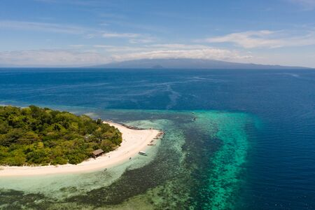 White sandy island with coral reefs.White sandbar.Atoll near the island of Camiguin, Philippines, aerial view.Seascape, white sand island