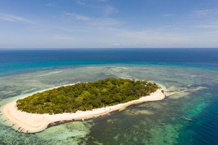 Mantigue Island, Philippines. Tropical island with white sandy beach and coral reefs. Seascape, view from above. Banco de Imagens