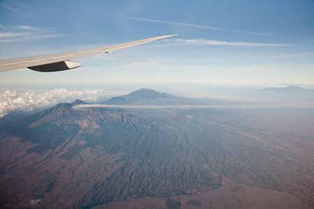 Mountain peaks of Indonesia, the view from the plane. Volcanoes of Indonesia.