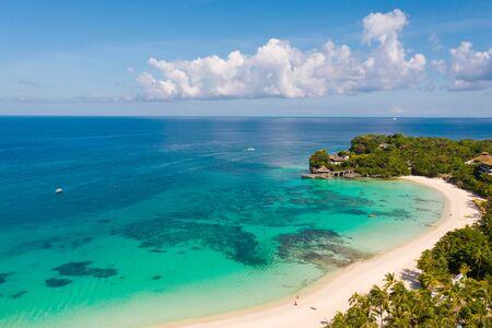 Beautiful Punta Bunga Beach on Boracay island, Philippines. White sandy beach and beautiful lagoon with coral reefs. The coast of the island of Boracay for tourists.