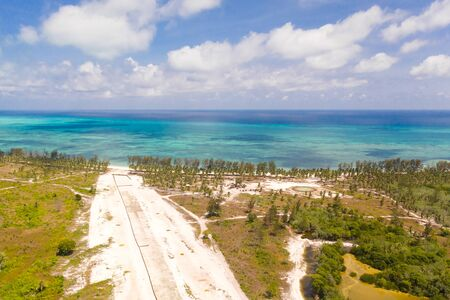 Runway on a tropical island, view from above. Balabac, Palawan, Philippines. Construction of the runway of the local airport on a tropical island. 写真素材