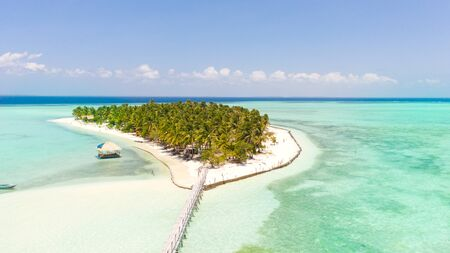 Tropical island surrounded by beautiful lagoons. Onok Island Balabac, Philippines. Rest on a tropical island. Nature of the Philippine Islands.