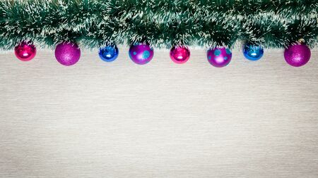 New Year banner with balls and tinsel. Christmas background with christmas decorations, top view.