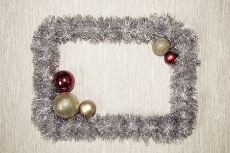 Frame made from silver tinsel decorations for christmas. Christmas tinsel garland, forming a rectangular frame with center copy space. tinsel frame background
