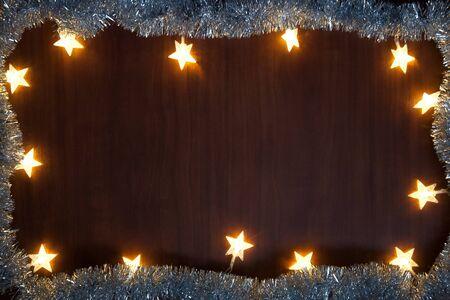 Garland of luminous stars. Christmas background with luminous garland. star frame