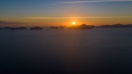 Sunset over the sea with the islands. Seascape with sunset aerial view