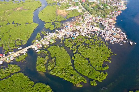 Town on the water and mangroves, top view. Coast of the island of Siargao. Tropical landscape.