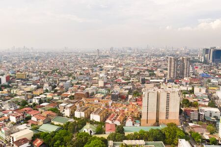 Residential areas and streets of Manila, Philippines, top view. Roofs of houses and roads. Philippine capital.