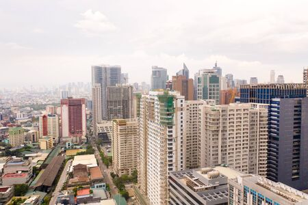 Modern city. The city of Manila, the capital of the Philippines. Modern metropolis in the morning, top view. Modern buildings in the city center.