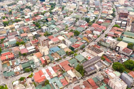 Residential areas and streets of Manila, Philippines, top view. Roofs of houses and roads. Philippine capital. Reklamní fotografie