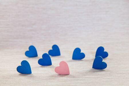 Wooden hearts on beautiful background. background for greetings on Valentines Day. Blue hearts.