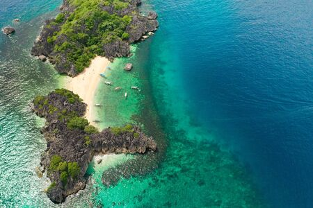 Travel concept: tropical sand beach and turquoise water view from the top. Lahos Island, Caramoan Islands, Philippines. Summer and travel vacation concept. Reklamní fotografie