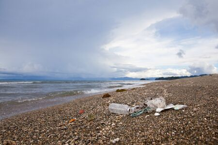 Plastic garbage thrown to the seashore. Plastic waste by the ocean. Reklamní fotografie