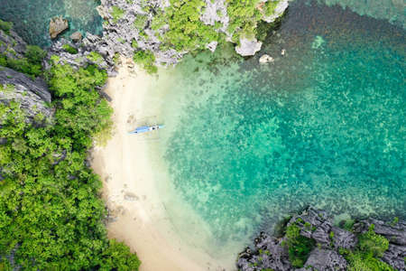 Small lagoon with sandy beach, view from above. Caramoan Islands, Philippines. Summer and travel vacation concept.