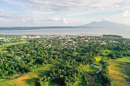 Sorsogon City, Luzon, Philippines. Asian town by the sea, top view. Tropical landscape with a town by the sea.