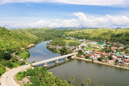 Road bridge on the island of Samar, Philippines. Bridge over the river, tropical landscape in the afternoon. Summer and travel vacation concept.