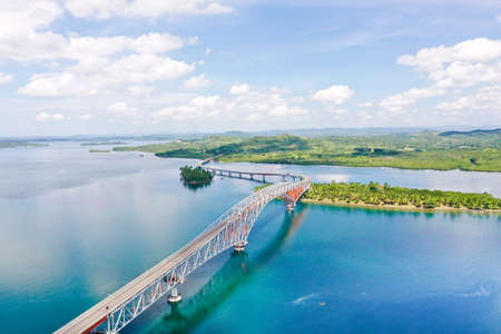 Panoramic of San Juanico Bridge, the longest bridge in the Philippines. Road bridge between the islands, top view. Summer and travel vacation concept.