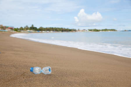 Plastic bottle on the beach. Garbage on a sandy beach.