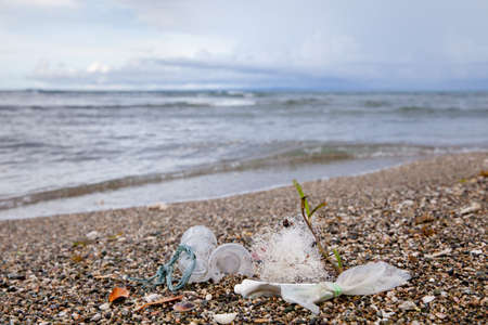 Plastic garbage thrown to the seashore. Plastic waste by the ocean. Reklamní fotografie