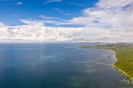 Beautiful seascape. Sea with lagoons and islands, blue sky with big clouds. Philippine nature.