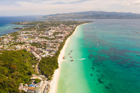 The coast of the island of Boracay. White beach and clear sea. Seascape with a beautiful coast in sunny weather. Residential neighborhoods and hotels on the island of Boracay, Philippines, view from above. Reklamní fotografie