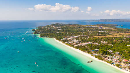 White beach on the island of Boracay, Philippines, top view. White sandy beach and turquoise sea water in sunny weather. Residential development and many hotels in Boracay.