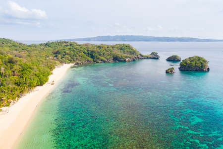 Ilig Iligan Beach. White sand beach and clear coral lagoon. Coast of the island of Boracay, Philippines, top view. Reklamní fotografie