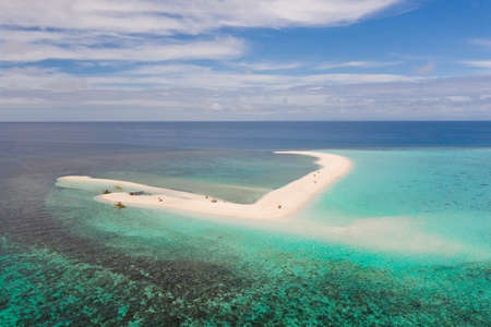 Atoll with an island of white sand. Sand beach island on a coral reef, top view. Tourist route on Camiguin Island, Philippines. Reklamní fotografie