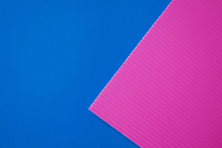 Abstract flat lay background with color crepe paper sheets. Pink and blue.