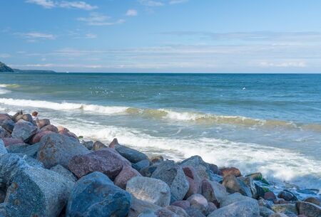 Seascape with round stones on the shore. Baltic sea. Stock fotó