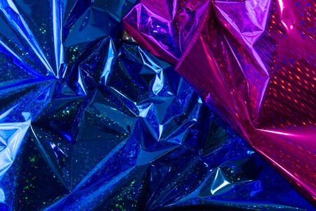 Creative photo background of blue and purple crumpled foil with highlights and shadows Imagens