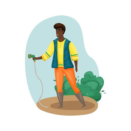 A man is watering the plantings in the garden with a hose. Planting, growing vegetables. The care of the garden. Agriculture, farming.