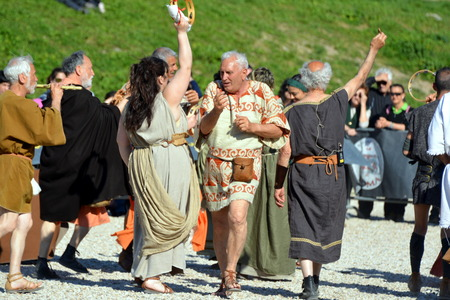 founding: ROME, ITALY APRIL 21: Actors dressed as ancient Roman citizens dance during the annual celebrations on the 2,768th anniversary of Rome founding on April 21, 2015