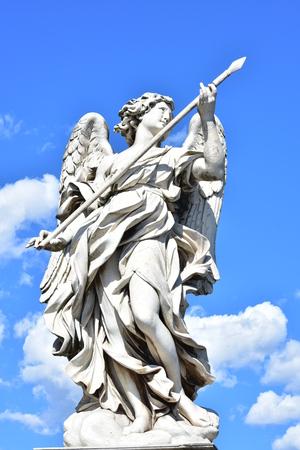 bernini: Bernini marble statue of archangel with spear from Ponte SantAngelo Bridge of Hadrian in Rome Stock Photo