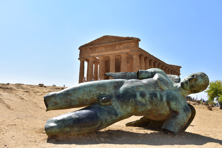 Fallen Icarus bronze statue in front of the Temple of Concordia - Agrigento - Sicily - Italy Editorial