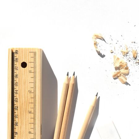 Pencil case and pencils are lying on the table in bright daylight. Natural unpainted wood. Eco-friendly materials.