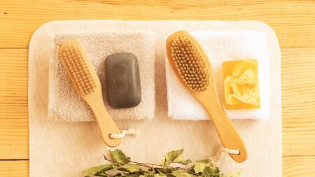 Set for a bath for a couple. Two towels, soap and body brushes. Vacation together. Pleasant warm color of natural materials Banco de Imagens
