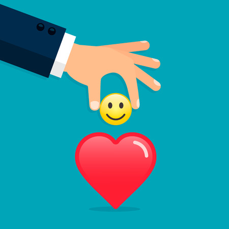 Hand put emoticon smile in heart, giving a good mood concept illustration. Vector concept.