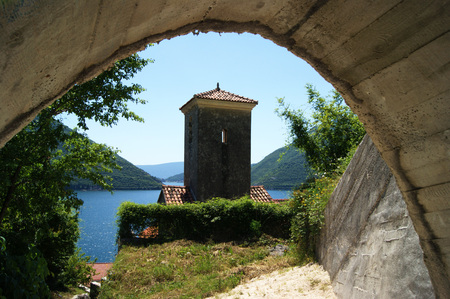 estival: The bell tower of the monastery in Perast