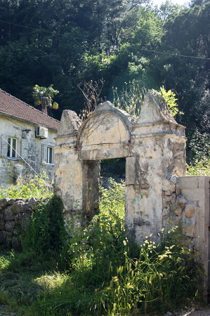 Fragment of old buildings - the entrance gate