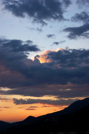 extramural: Dark clouds on the sunset sky