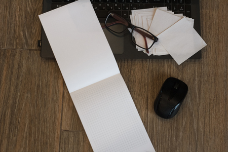 Office accessories: laptop, notebook glasses Stock Photo